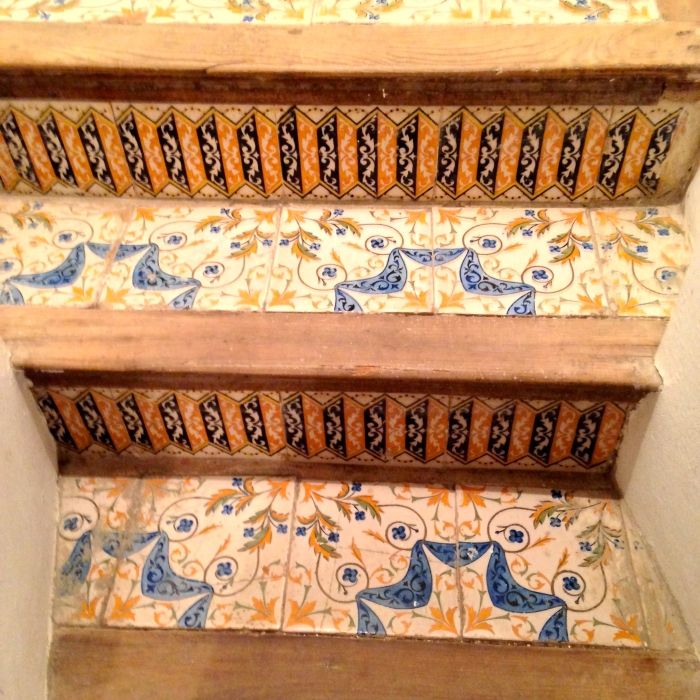 Tiles on steps to cellar