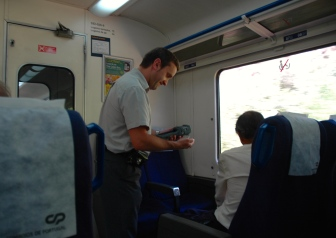 ...and the smiling conductor issues tickets