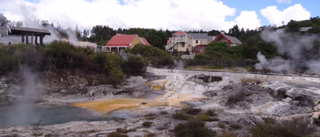 Houses set amongst boiling pools and steaming vents.